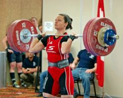 Christine Clean and jerking 134kg. Credit @ Christine Girard