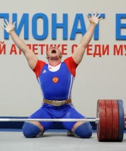 Russian Andrey Demanov reacts as he lift