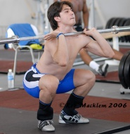 Sagir, front squatting with knees not pushed out, at least in the powerlifting sense. Credit : Macklem