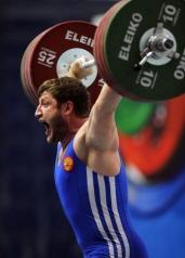 Russian Khadzhimurat Akkaev lifts weight