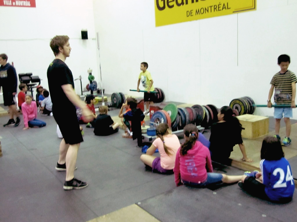 Action shot (more like blurry shot) of me hosting a summer camp at Club  Les Géants de Montréal. I think about 60 kids visited us that day. About 27 left their phone number for me to send information to their parents. Fun experience.