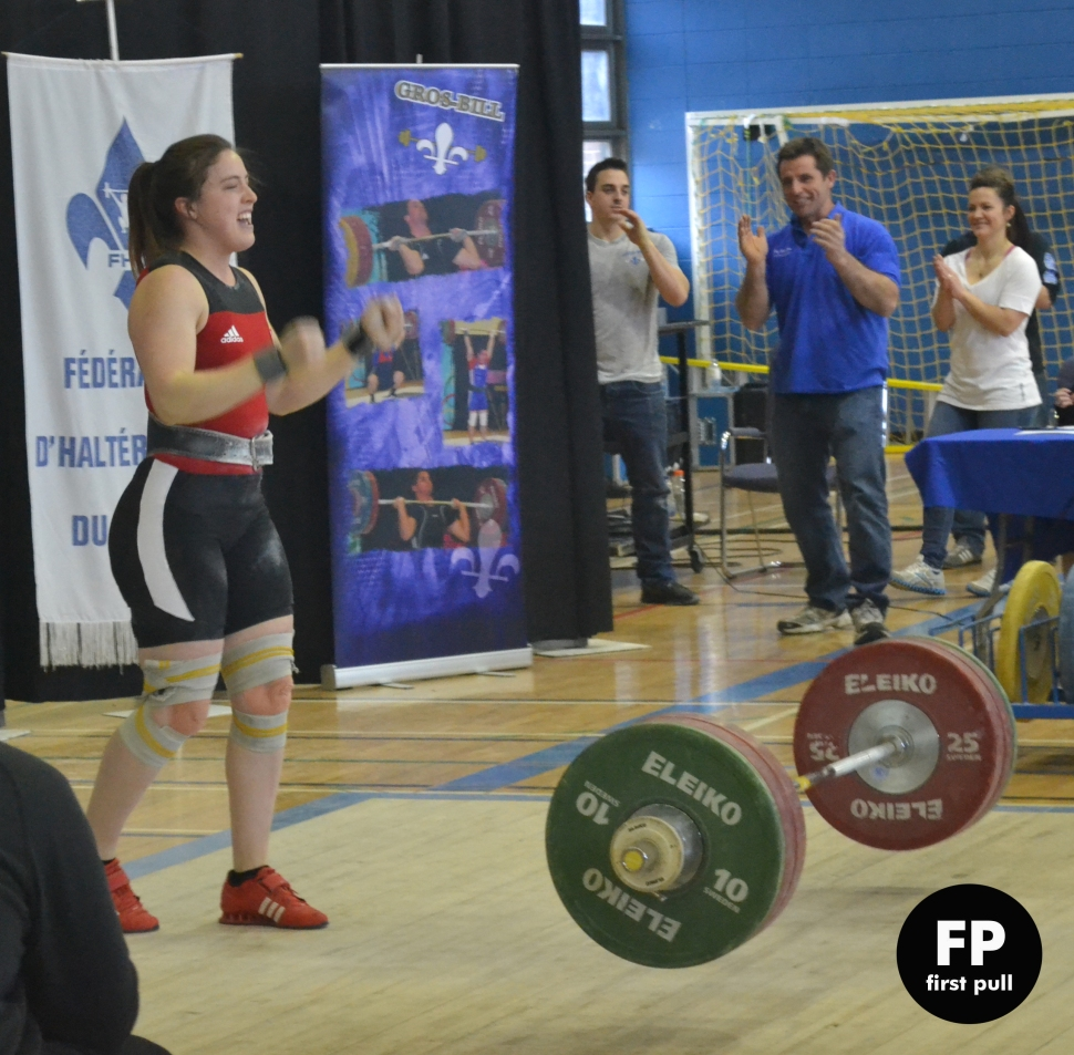 Marie-Ève celebrating her successful 141 clean and jerk. Guy Marineau is in the back